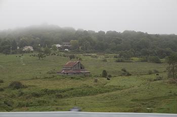 8 25 raw red barn in country field.jpg