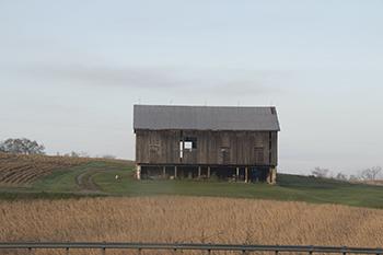 12 14 raw barn and farm house in winter.jpg