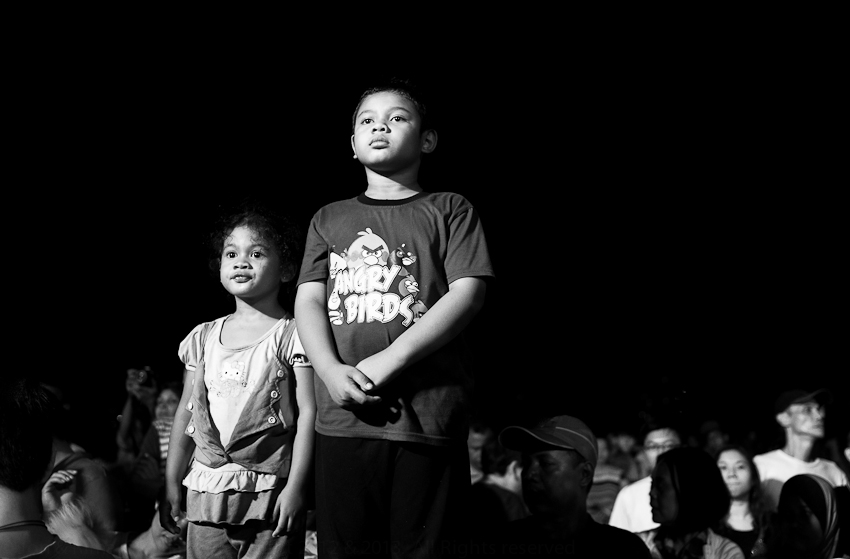 Kids waiting for the fireworks at Chinese New Year, Penang, February 2012