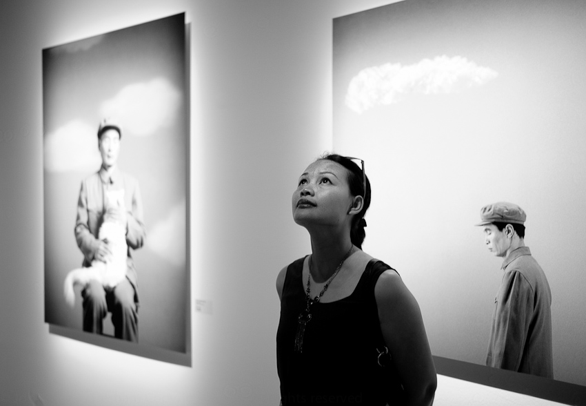 Rima beside Images by Wang Ningde, Flux Realities, Art Science Museum, Singapore, September 2014