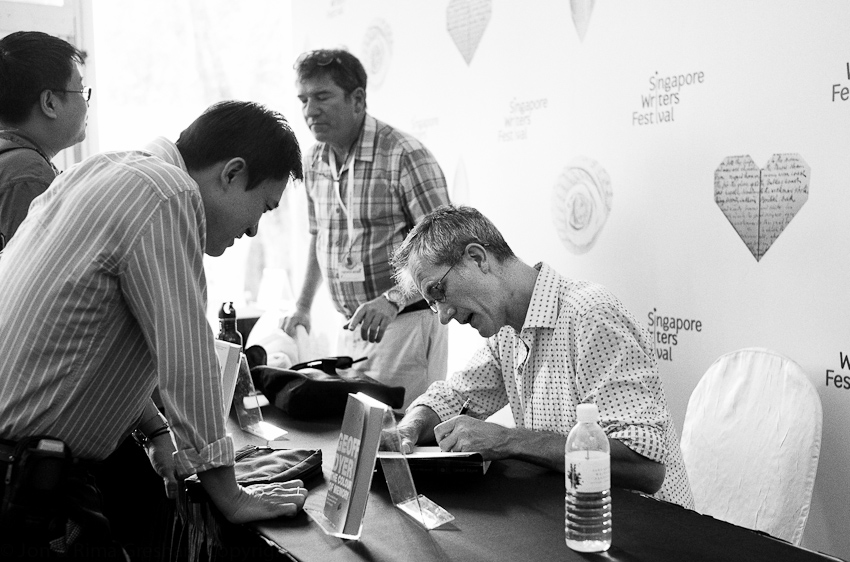 Geoff Dyer signing books