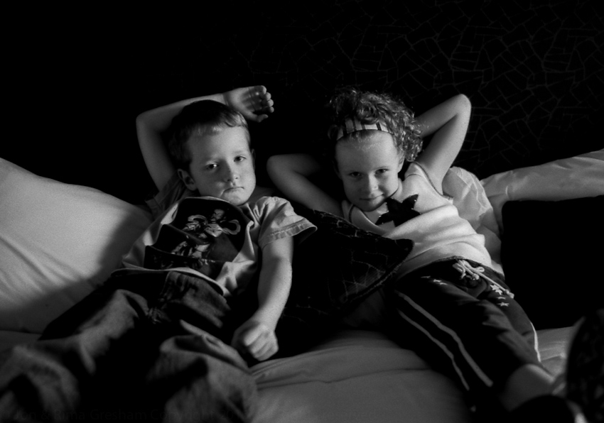 Charlie & Lily at Palm Resort, Malaysia, watching American Idol while I babysit them in 2004