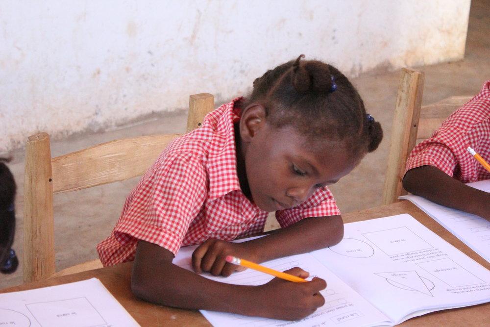 Wesliene (Preschool) writing O.JPG