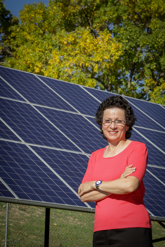 Tietjen photographed in front of the solar panels at the Loretto Spirituality Center