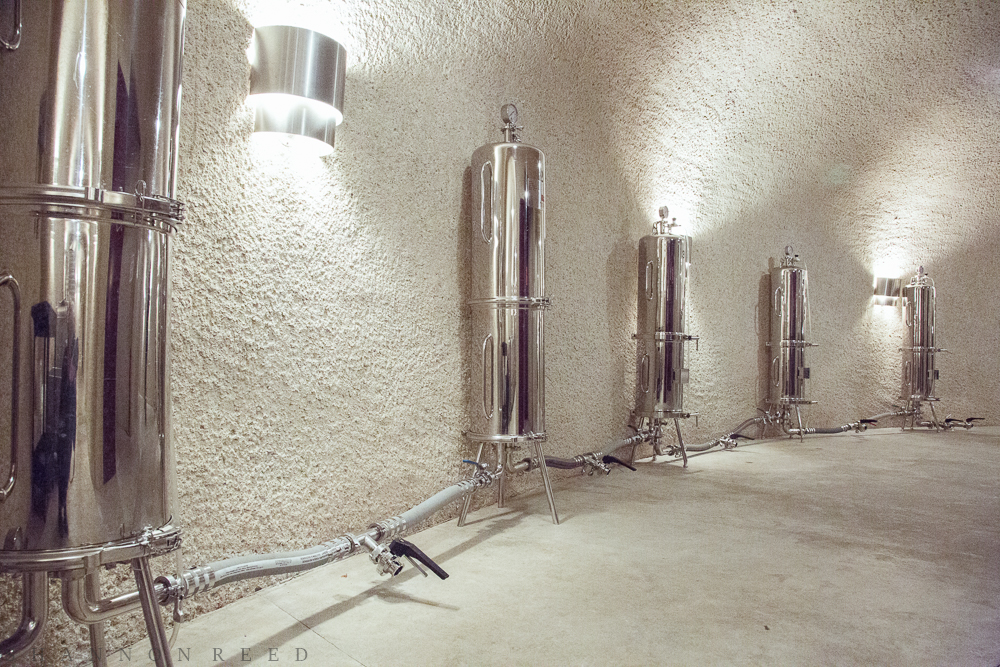 Before the fermentation tanks, the wines go through each of these five petite paper filter tanks...