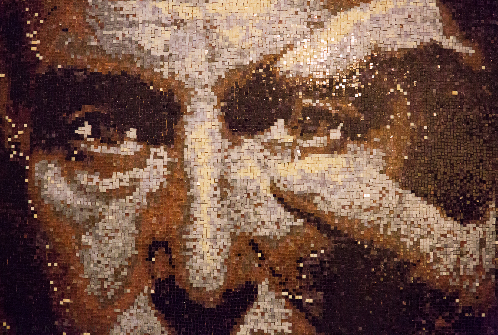A mosaic of Julio Palmaz holding his famed mesh stent...
