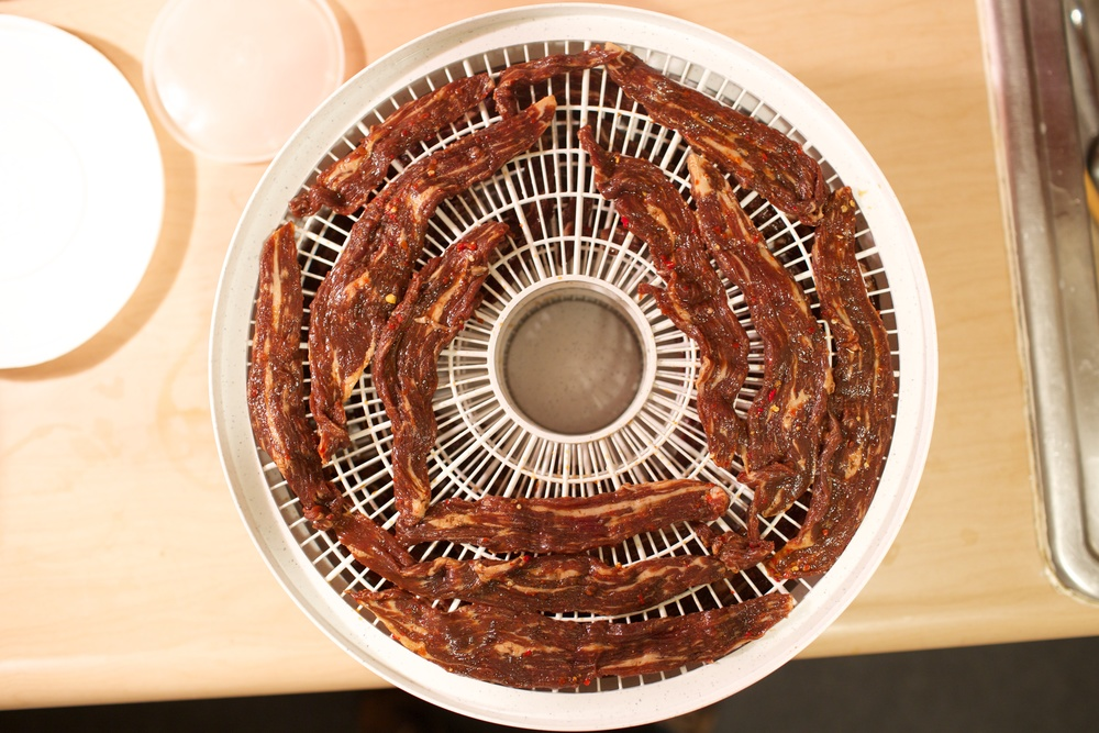 The spicy Alton Brown beef jerky on the Nesco food dehydrator trays