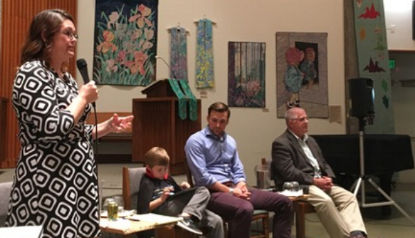 PICTURED ABOVE: SENATOR SARA GELSER ANSWERS A QUESTION. SEATED ARE REPRESENTATIVE DAN RAYFIELD (DISTRICT 16), CENTER, WITH HIS SON; REPRESENTATIVE MIKE NEARMAN (DISTRICT 23) IS AT RIGHT.
