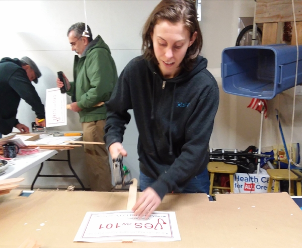 Advocate Jenn Wig makes posters in support of measure 101. the special election is in January, and all ballots must be in by January 23. Watch your mailbox for the ballot!