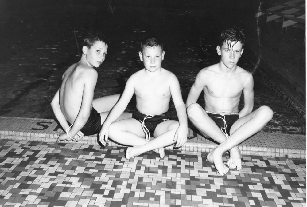 Alan, Gary and Lloyd Cates are being tied up before being pushed into the pool.