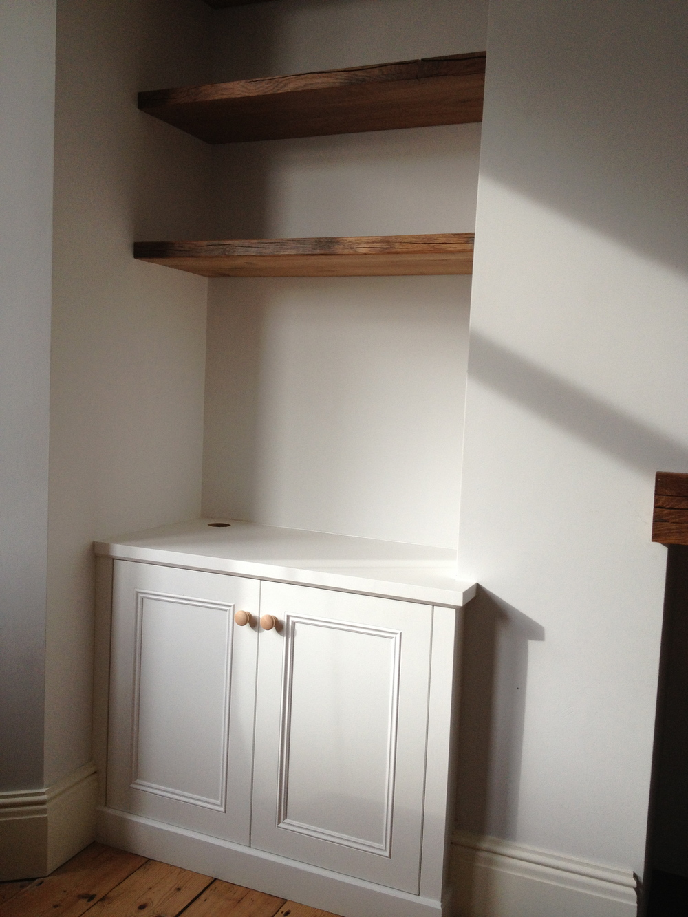 Alcove cupboard with solid oak reclaimed floating shelves