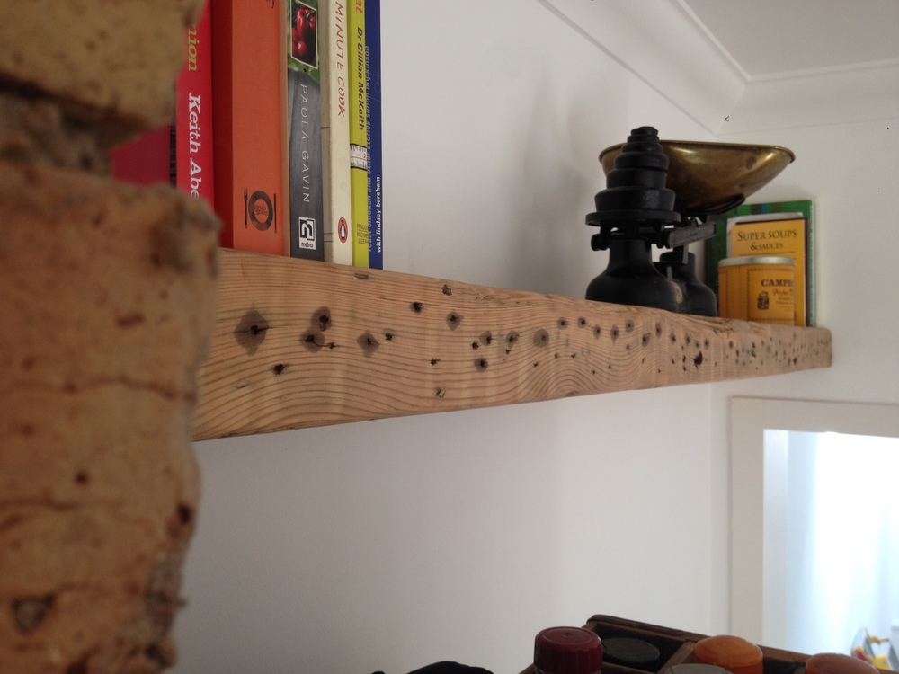 Two metre long floating shelf, made from reclaimed pine joist