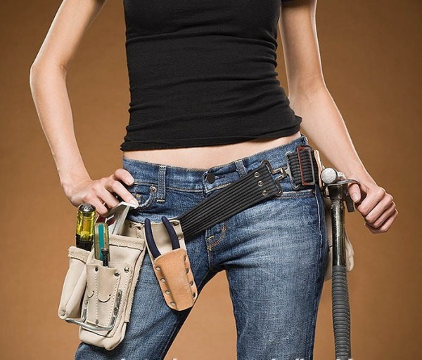 woman_repairing_with_toolbelt.jpg