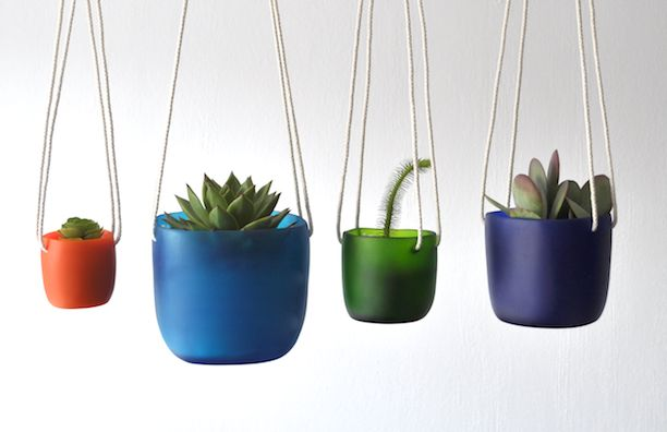 Tina Frey Designs hanging vessels colored resin.jpg