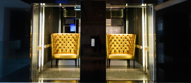 african pride hotel cape town south africa gold chairs in elevators.jpg