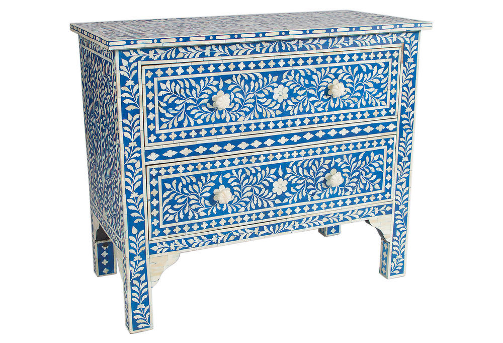 No more boring bedroom storage! We're in love with the rich blue background and white bone inlay of this piece.