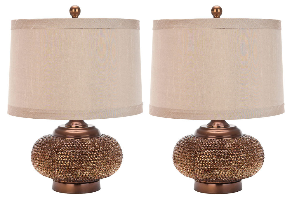 We love the curvy, sensuous shape of these Jasmine Beaded Table Lamps and the warmth of their cream shades.