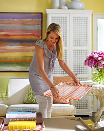 Rebecca Robertson interior designer decorating a room.jpg