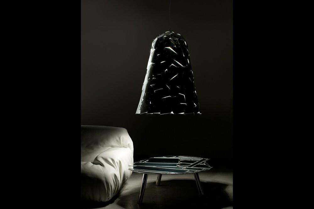 Campana pendant light over side table with sofa.jpg