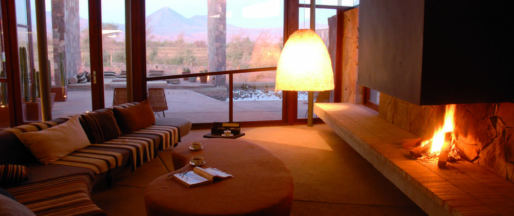 lobby fireplace seating at Hotel Tierra Atacama in Chile eco tourism.jpg