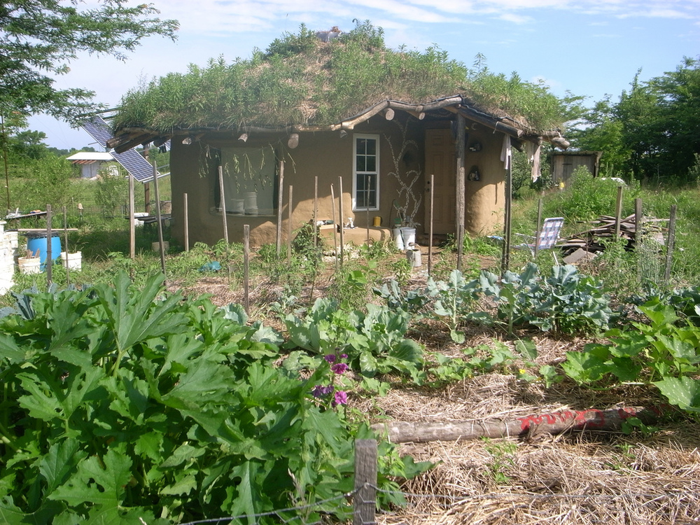 cob-house-with-vegetable-garden-plot.jpg