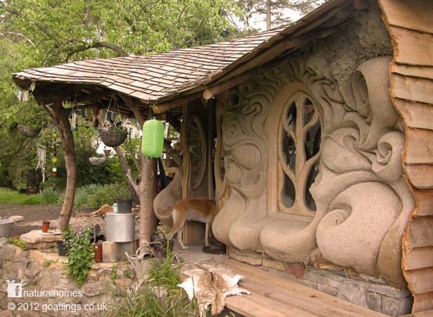 English-cob-house-porch-fancy-window-curves-in-cob-wall.jpg
