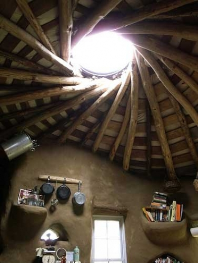 interior-kitchen-of-a-cob-house-with-roof-beams-and-round-skylight.jpg