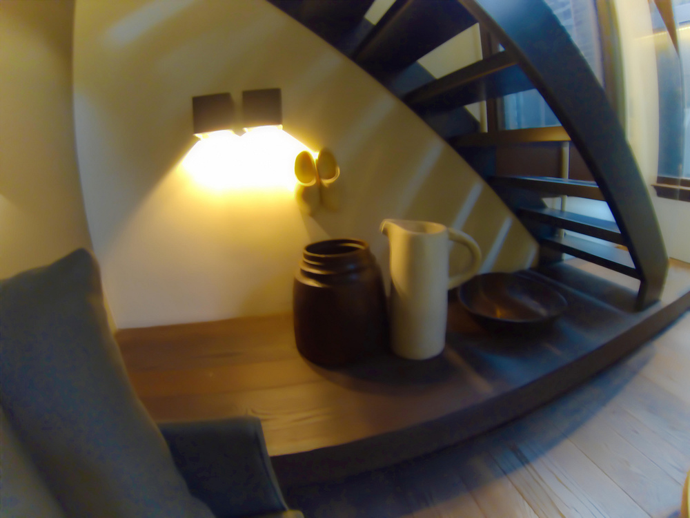 conservatorium-hotel-amsterdam-bottom-level-hotel-room-seating-area-Dutch-tableau-under-stairway.jpg