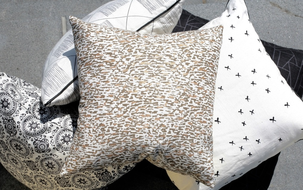 Pillows by Fabric and Steel (l to r): Salvage, Transparency, Gravel, Cross-section, Pavement
