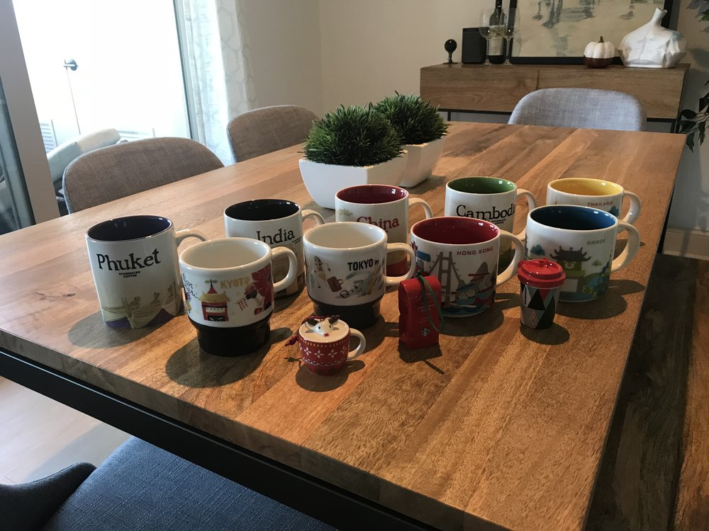 All of the Starbucks mugs we collected on our Grand Adventure.