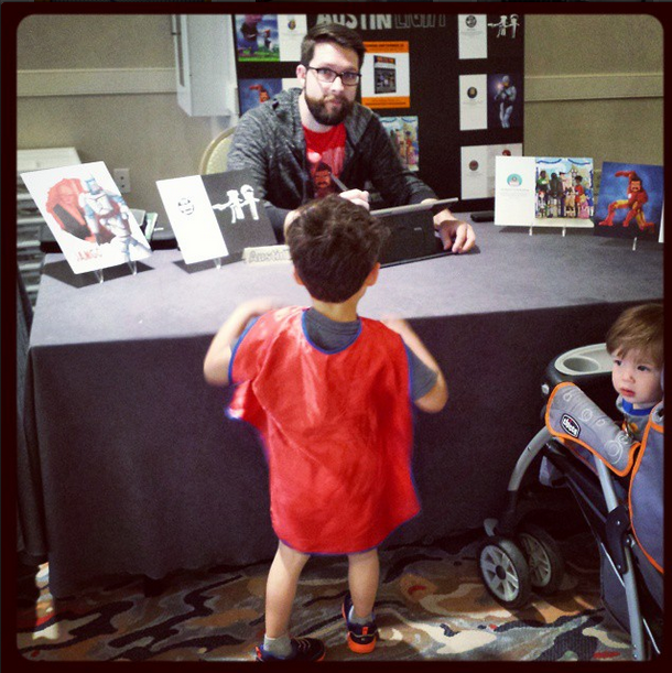 Me at my booth with my sad art display and my homemade sign.My two boys were into it.