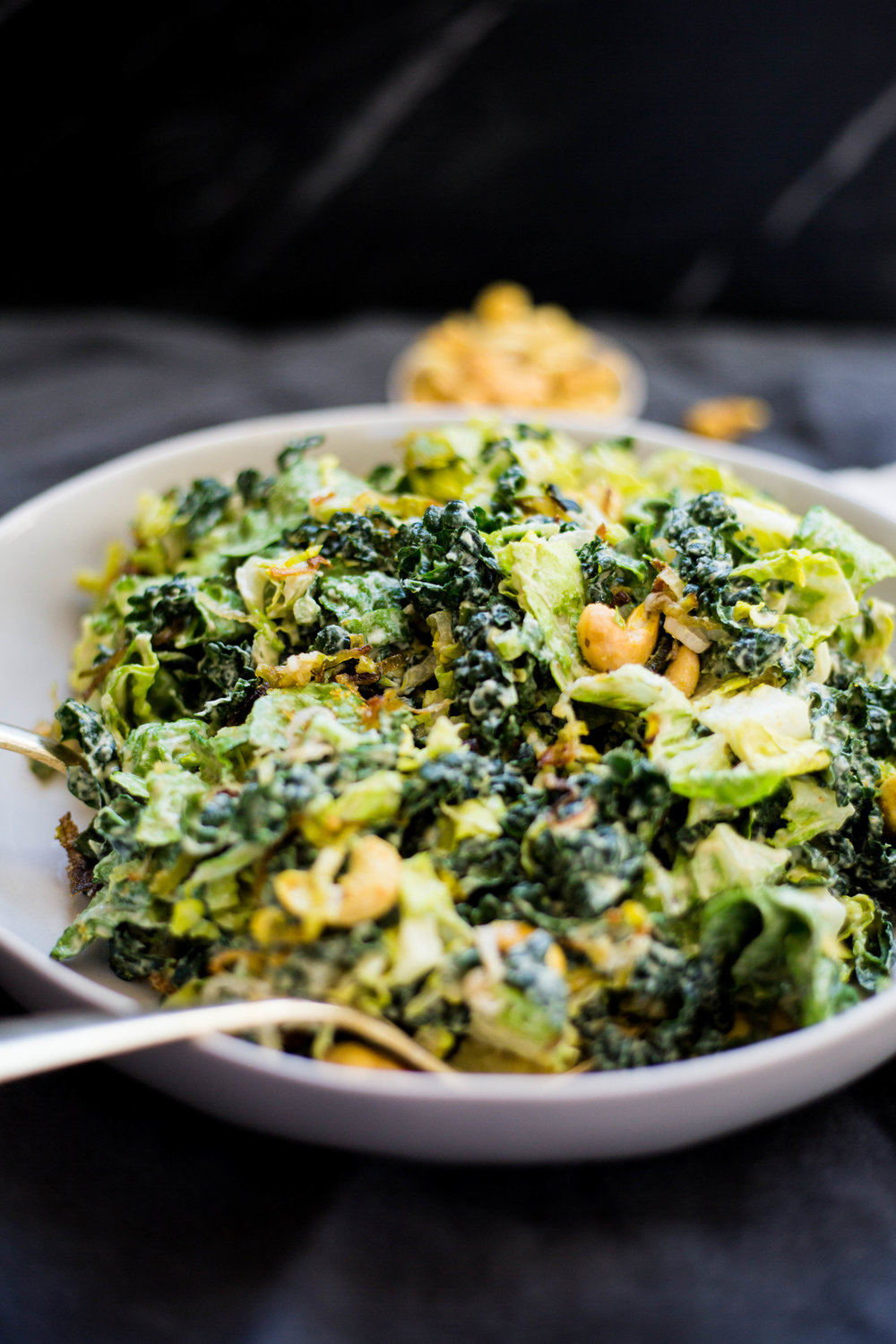 Creamy Kale Caesar Salad with Cashew Croutons and Crispy Leeks. Recipe and photos via PureKitchen Blog