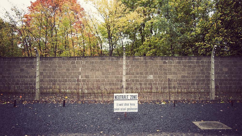 "The ""Death Strip"" where prisoners were shot on sight. Rows of barbed wire lined the first fence."
