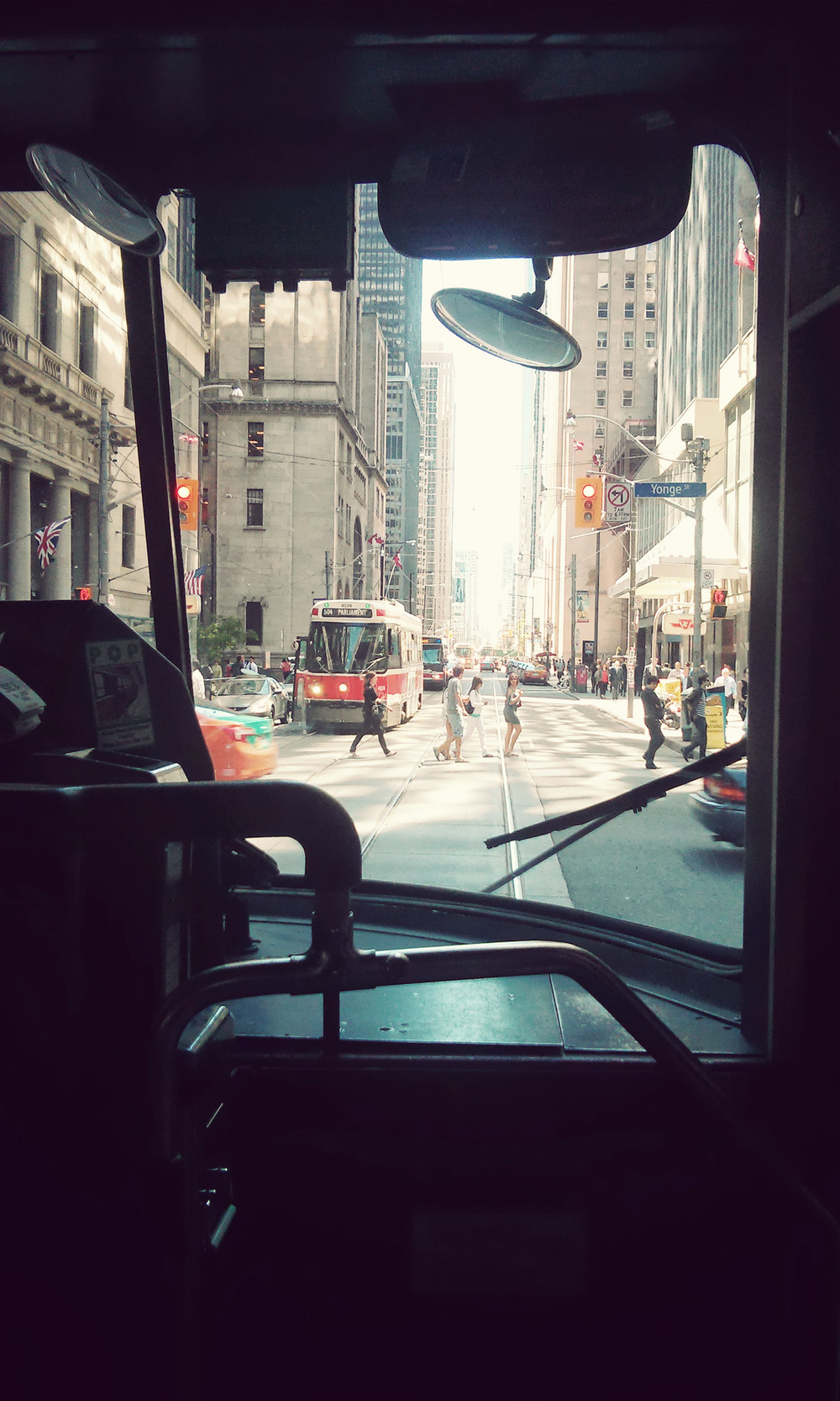 I like downtowns. I like Toronto's downtown - it's busy and active and alive and still has some nice historic high-rises. I am also a big fan of trams, in spite of the fact that they slow traffic and make bike riding treacherous.