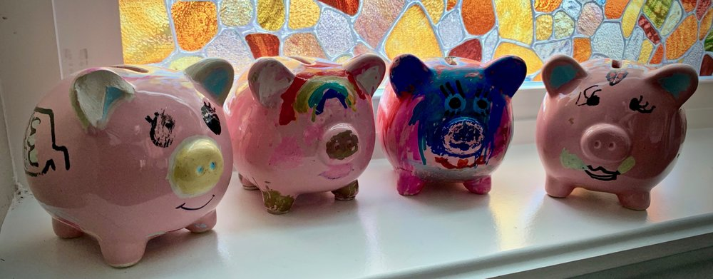 Our daughters personalized their piggy banks with paint pens. They are well loved, and get the occasional touch-up or modification.
