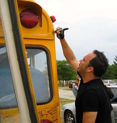 dave signing short bus
