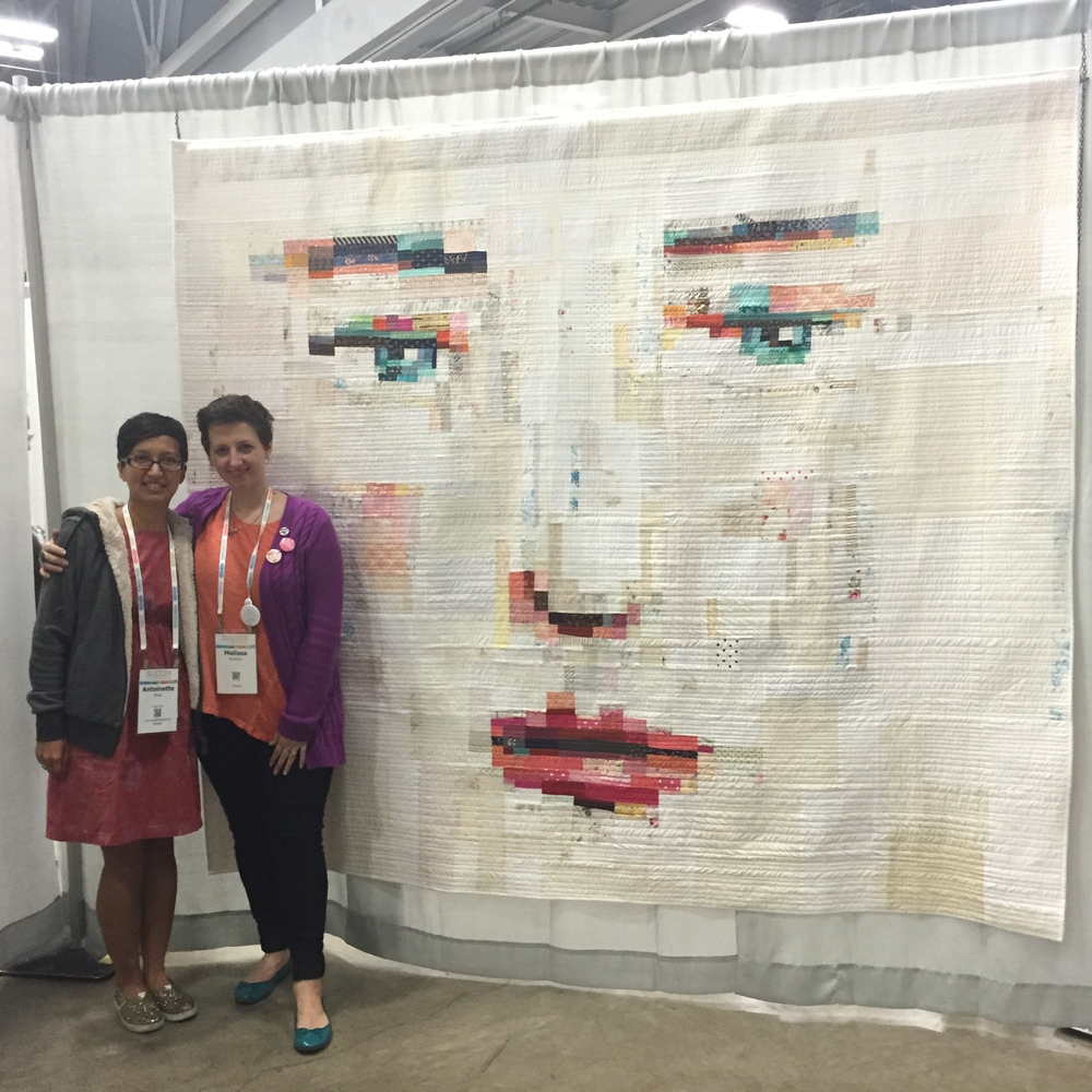 Melissa Averinos and her award winning quilt
