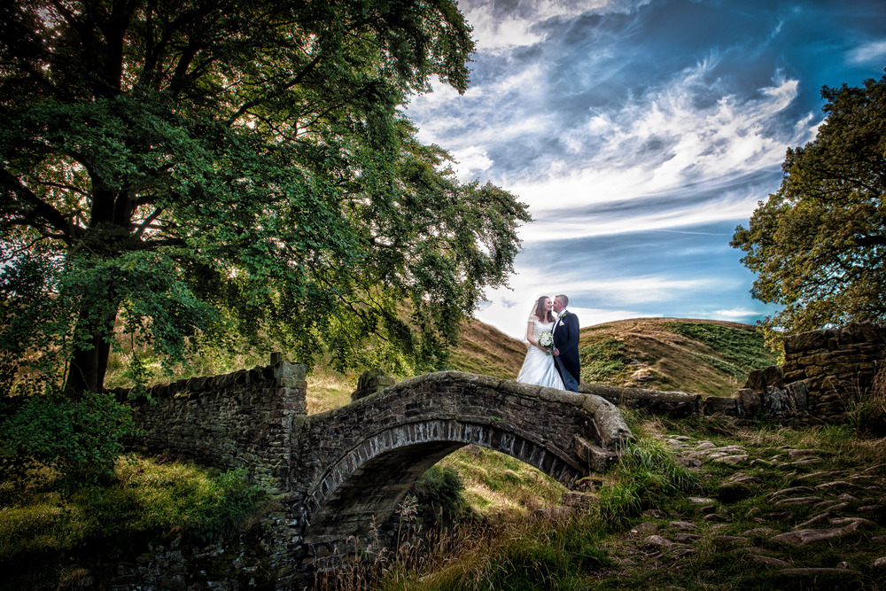 A beautiful day to get married in Marsden, West Yorkshire. Louise had a clear vision for a photograph on this bridge and was prepared to make the wedding party wait as we walked out to get it.