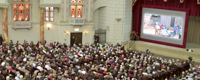 Invited Jehovah's Witnesses pack the Stanley theater auditorium for