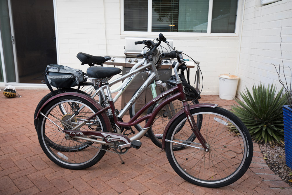 A Schwinn city bike, a Gary Fischer mountain bike, and a Town & Country cruiser.