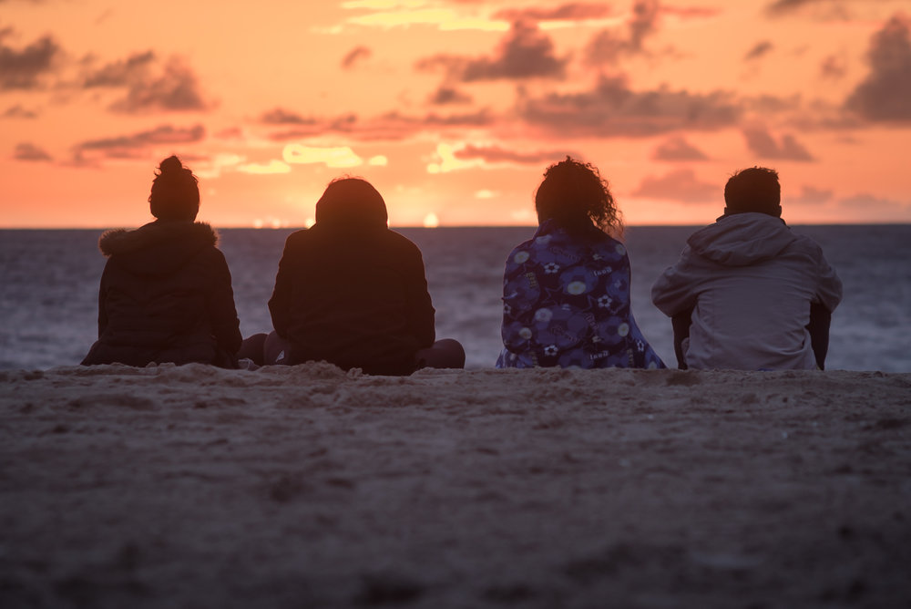 beach-sunset-sitting-friends-willventures.jpg