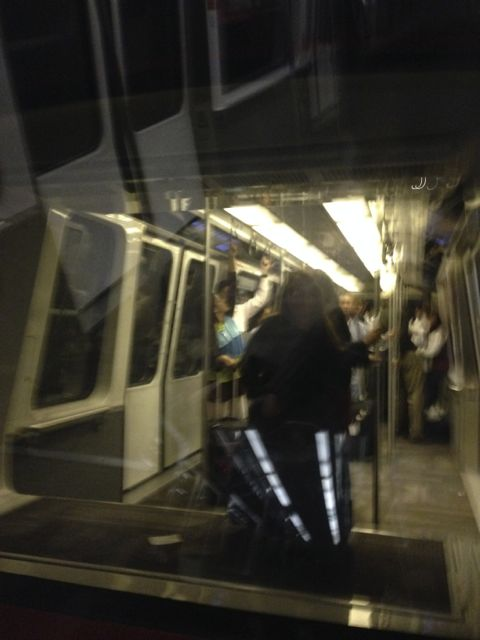 Erin spys J$ through the monorail car in ATL