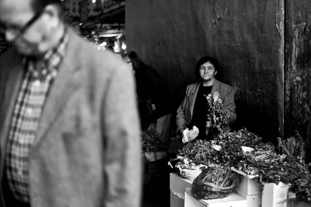 A woman sells garlic at the Agora, the central market of Athens, on November 17, 2012.