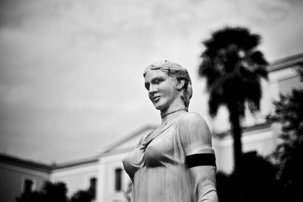 A classical statue on Akadimias Street in Athens is arm banded in mourning for Greece's current economic situation on November 16, 2012.