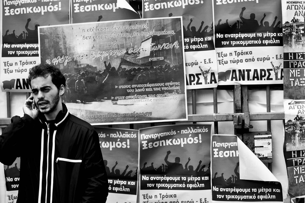 A man talks on his cellphone at the Athens Polytechnic at a rally commemorating the 1973 student uprising at the Polytechnic on November 16, 2012.