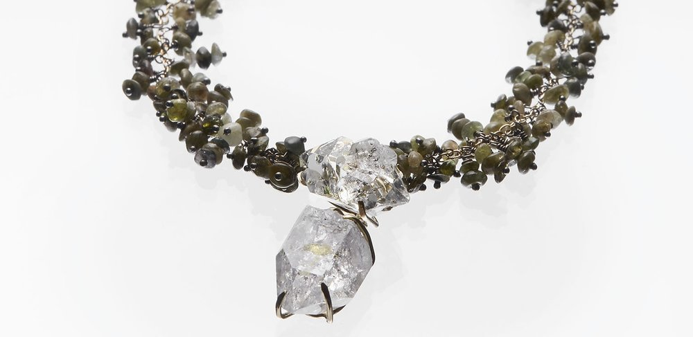 Michelle Pajak-Reynolds Voyageuse Collection Desma necklace with Golden Enhydro Quartz, Tourmaline, Recycled 18k Gold, and Recycled Oxidized Sterling Silver. Photo credit: Julie Stanley/JuleImages