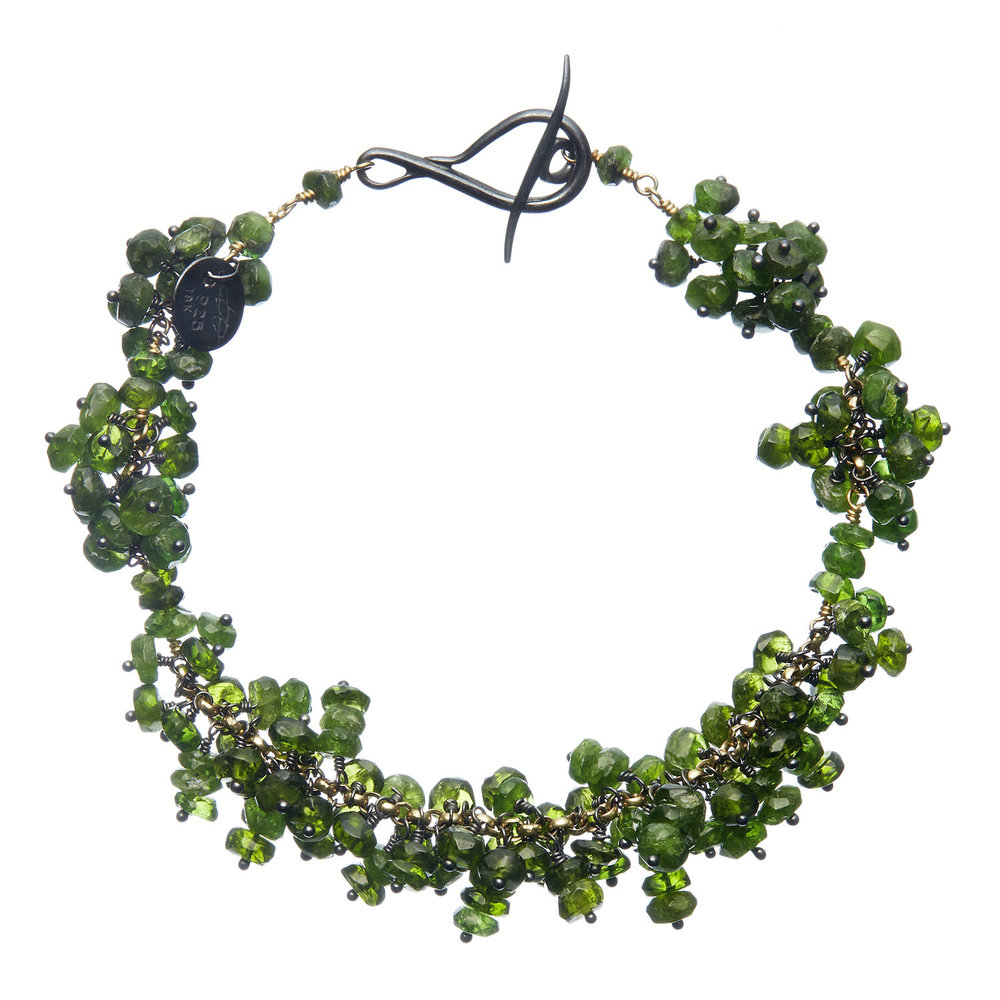 One-of-a-kind    Pellia bracelet    from Michelle Pajak-Reynolds's    Voyageuse Collection    featuring 44.41 carats (total weight) pin-set vesuvianite, recycled 18k gold, oxidized sterling silver and a hand forged clasp. Photo credit:    JuleImages
