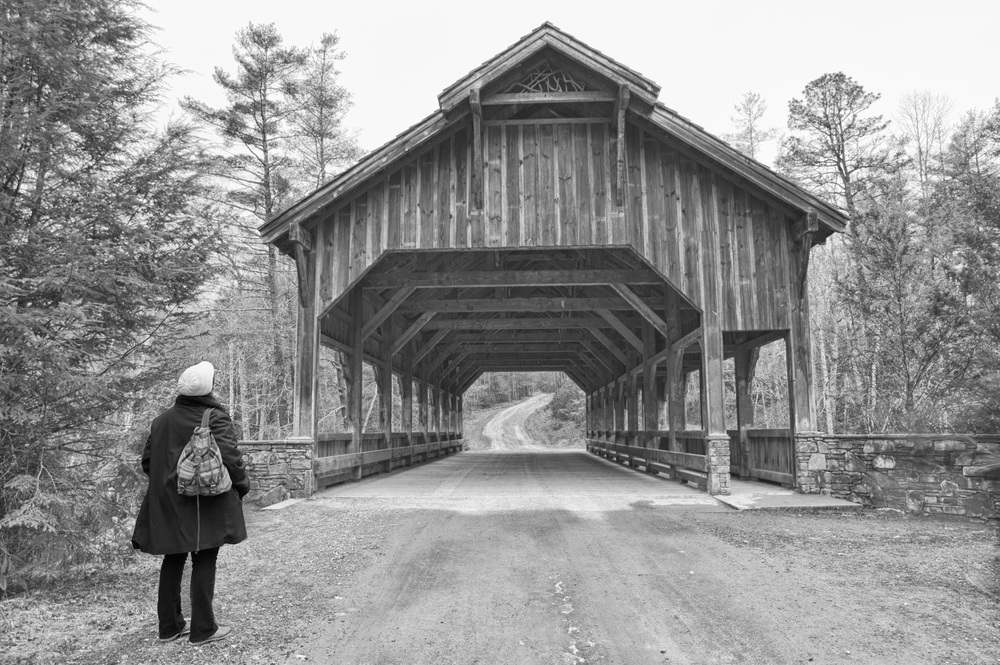 My wife looking at the covered bridge. Photographer: John Puett.