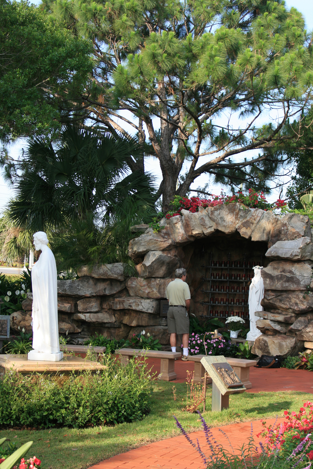 Meditation Garden at St. Peter Catholic Church Jupiter Entry to Grotto Pine Trees.jpg