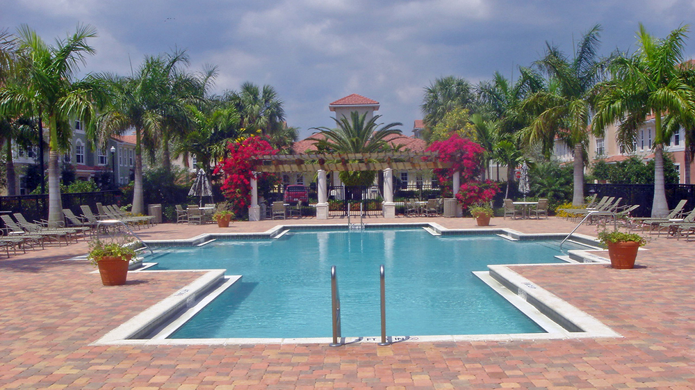 The Gables Floresta Jupiter Florida Clubhouse Pool Deck Royal Palms Trellis.jpg